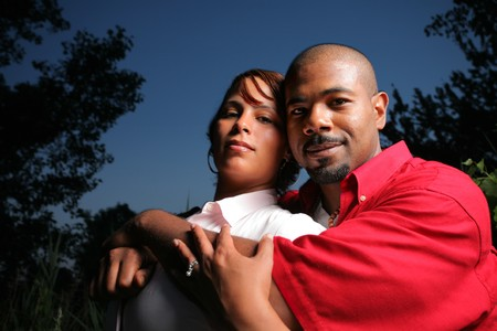 affectionate: Happy African American couple together outdoors, close-up.