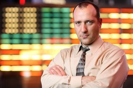 Businessman over stock exchange background photo