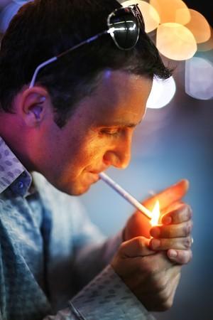 Man lighting a cigarette. Shallow DOF.