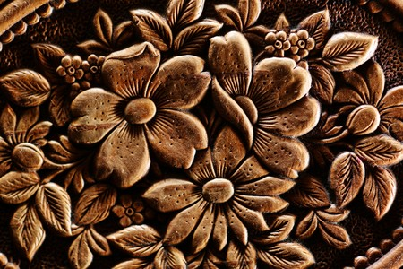 wood carving: Vintage flowers relief texture background. Extreme macro close-up.