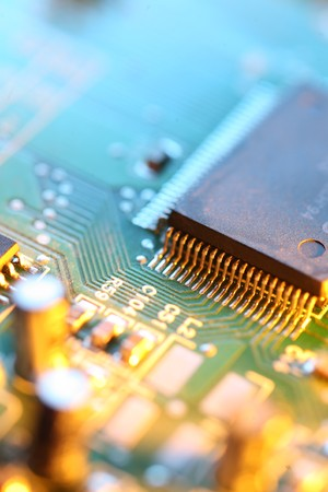 hardware: Circuit board abstract background texture. Macro close-up. Stock Photo
