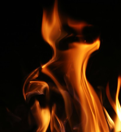 hellish: Fire flames over black background texture