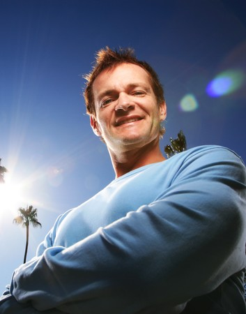 backlit: Confident man outdoors.  Stock Photo