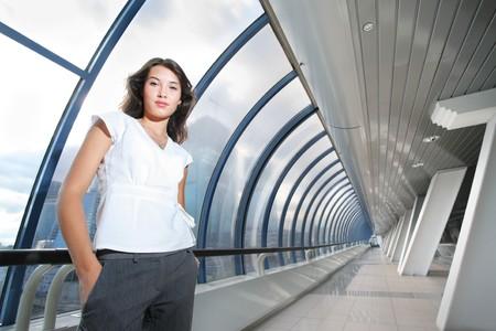 Confident young businesswoman in futuristic inter. Stock Photo - 4319984