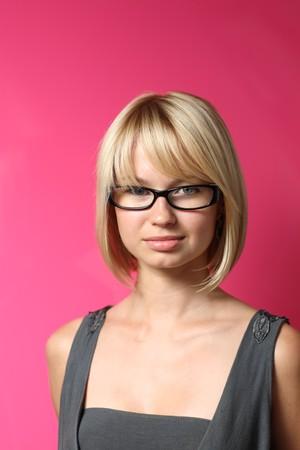 Beautiful businesswoman over pink wall photo