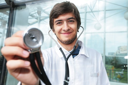 Portrait of a doctor holding stethoscope Stock Photo - 4319958