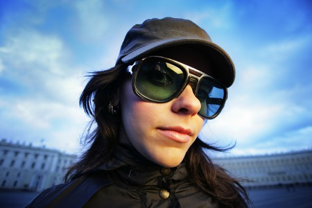 Wide angle portrait of a girl in sunglasses photo