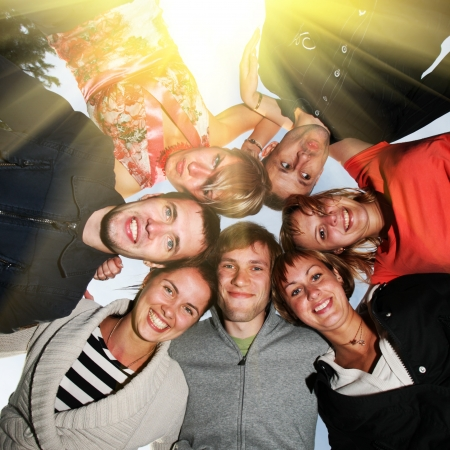 male friends: Group of happy young people in circle outdoors Stock Photo