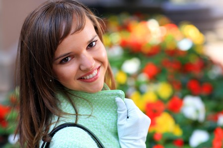 Beautiful young woman with flowers background Stock Photo - 4319959