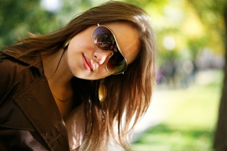 Portrait of a beautiful young woman in autumn park. photo