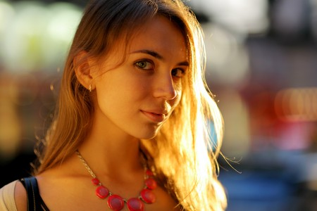Portrait of a beautiful young woman in sunlight. Shallow DOF.