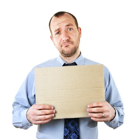 fired: Businessman begging for help with cardboard sign Stock Photo