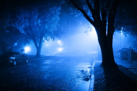 eerie: Foggy street at night