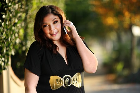 Beautiful plus size model outdoors. Shallow DOF. photo