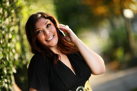 plus size: Beautiful plus size model outdoors. Shallow DOF.