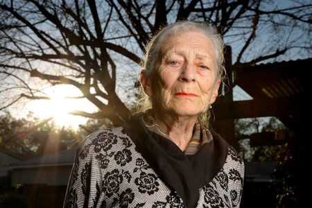 mature old generation: Portrait of a sad senior woman outdoors Stock Photo