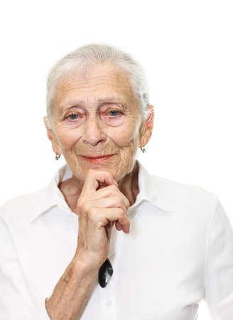 Portrait of a senior woman smiling in camera. Isolated over white background. photo