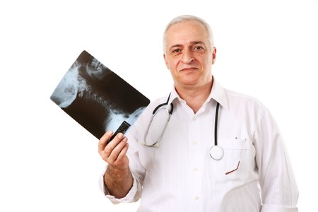 Friendly mature doctor with the human neck x-ray. Isolated over white background. photo