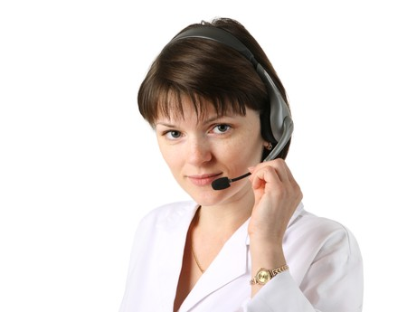 contact center: Young female clinic receptionist wearing headset. Isolated over white background.