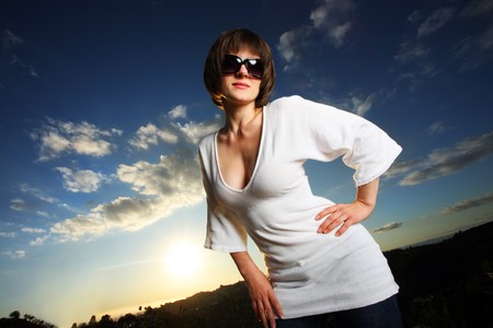 Beautiful woman outdoors at sunset