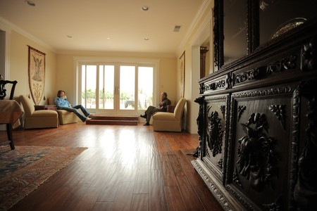laminate flooring: Spacious interior with antique cabinet in foreground