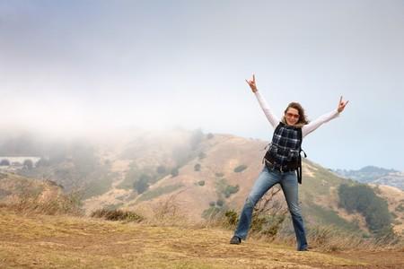 Happy young woman exploring Northern California. San Francisco, Golden Gate vista point, USA.