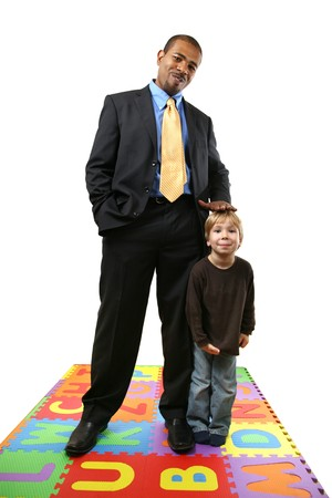 role: Tall African American businessman together with small caucasian boy.