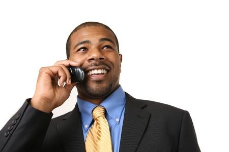 phone business: African American businessman talking on mobile phone, smiling. Close-up, isolated over white.