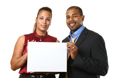 African American couple in business attire holding small white blank sign in front of them. Isolated on white. photo