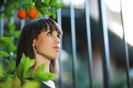 Beautiful girl in orange tree garden. Shallow DOF. Stock Photo - 4320211