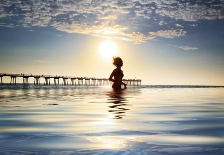 Woman in ocean enjoying sunset Stock Photo - 4320351