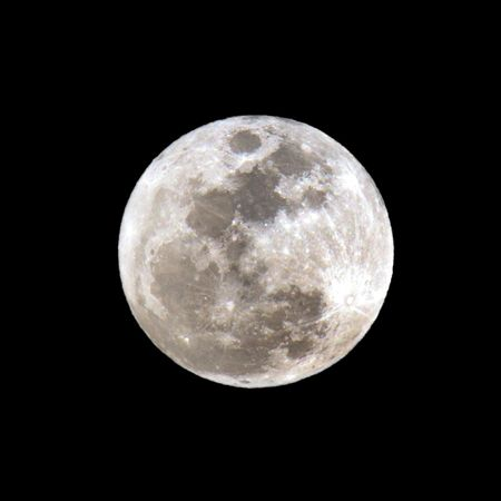 over the moon: Full Moon close-up over black sky Stock Photo