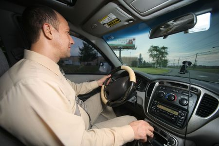 angle view: Businessman driving car, wide angle view. Stock Photo