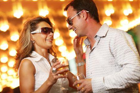 Adult couple enjoying nightlife with glasses of champagne. Shallow DOF. Stock Photo - 4665166