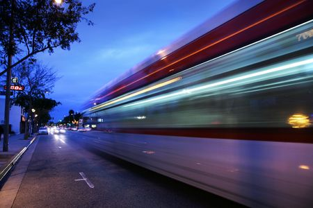 rapid: Speeding bus, blurred motion. Santa Monica Blvd., West Hollywood, USA Stock Photo