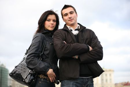Beautiful young couple together in city photo