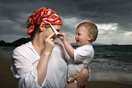 Mother and son at the ocean photo