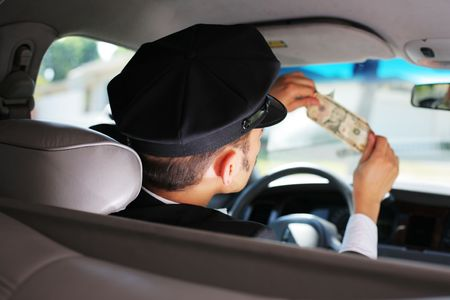 look inside: Taxi driver checking dollar bill