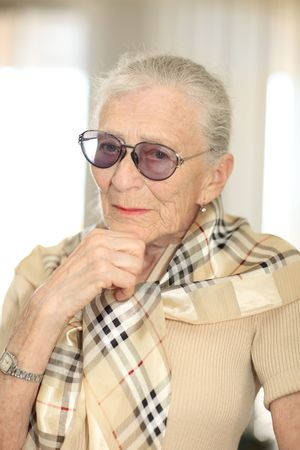 Portrait of a senior woman thinking. Shallow DOF. Stock Photo - 4710549
