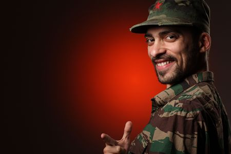 Portrait of a happy soldier over red and black background Stock Photo - 4710553
