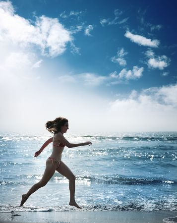 Silhouette of young woman running along beautiful ocean Stock Photo - 5317967