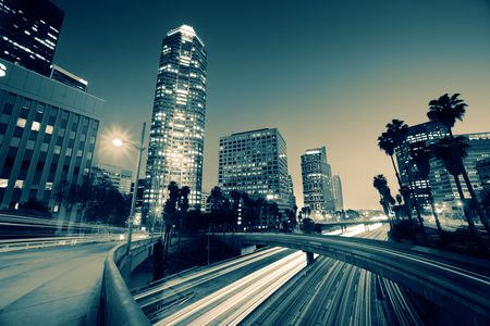 skyscraper sky: Freeway traffic in downtown Los Angeles at twilight. Stock Photo