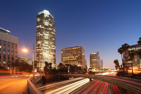 los: Freeway traffic in downtown Los Angeles at twilight. Stock Photo