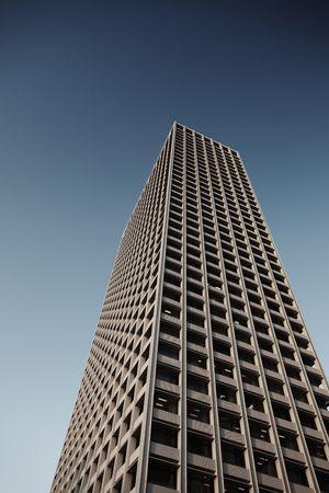 highriser: Office tower over blue sky