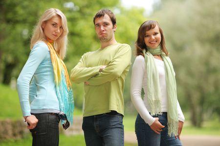 Man between two beautiful women. Shallow DOF. photo