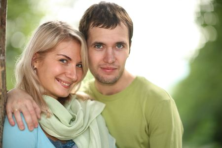 Portrait of happy young couple together in park. Shallow DOF. Stock Photo - 5947198
