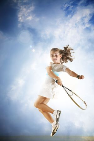 tennis serve: Young girl playing tennis Stock Photo