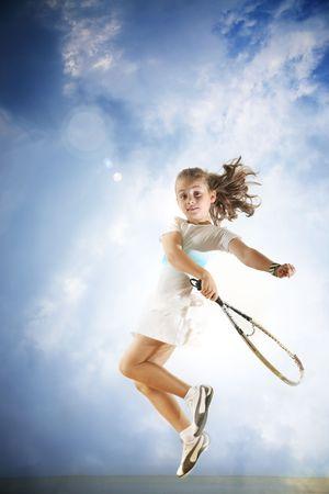tennis racquet: Young girl playing tennis Stock Photo
