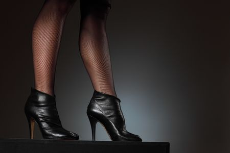 Sexy female legs in high heel boots photo