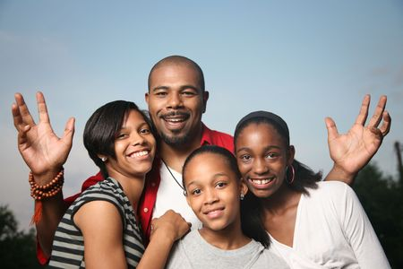 diverse hands: Happy African American family. Father with three teenage daughters together having a good time.